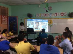 """Mariela haciendo """"outreach""""en la Escuela Especializada en Ciencias y Matemáticas Genaro Cautiño en Guayama PR 1"""